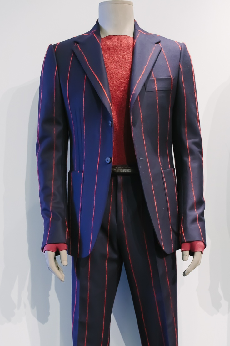 Custom printed suit layered with straight neckline sweater. Complex and bold.