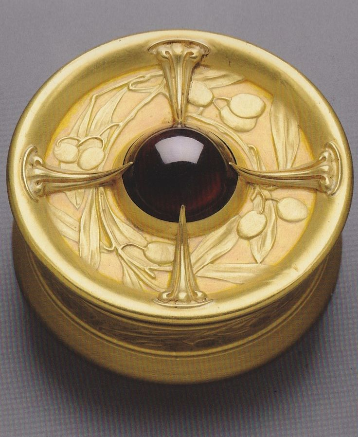 Box with olive tree motif, by René Lalique, circa 1900, gold, enamel and smoky quartz.