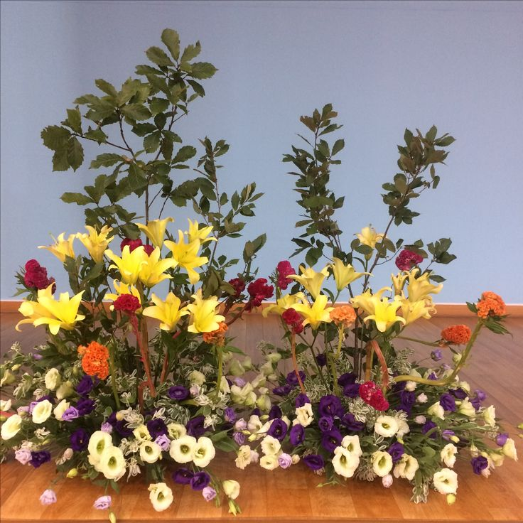 2017.8.13. This week's church flower decoration. Yellow lilies and white and purple color flowers.