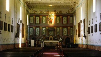The main altar and reredos at Santa Ines Mission