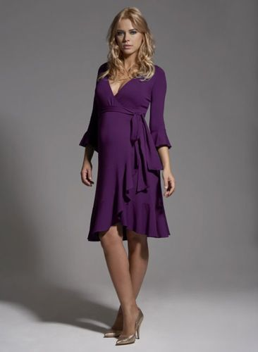 Purple is a gorgeous color on an expecting mom and this dress is nothing short of simple and stunning. Even though it has longer sleeves at 3/4, the layers on the bottom of the dress really define the legs and also the arms. Paired with good posing, these dress is amazing.