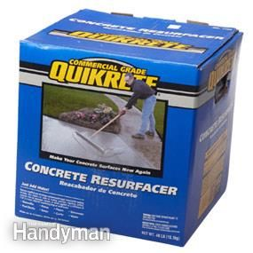 Container of concrete resurfacer for garage floor resurfacing.