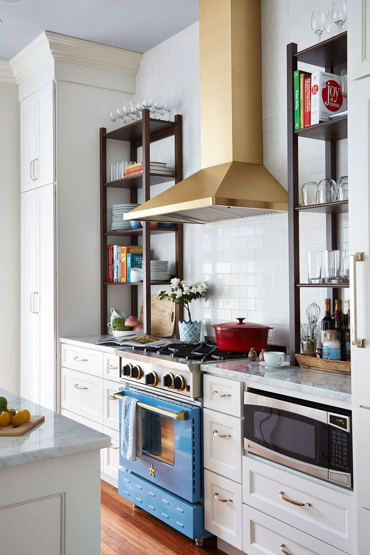 A Colorful, Neo-Trad Apartment in Chicago featuring a French-Blue Range by BlueStar and striking gold hood by Summer Thornton Design. BlueStar offers over 190 standard colors with 750 different finishes to choose from. We will even custom color match to help make the kitchen of your dreams! #BlueStar