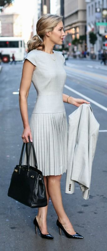 light grey pleated dress, matching suit jacket, black patent pointed toe pumps, work bag tote + pony tail hairstyle. What to wear to your next interview. The ultimate guide to what women should wear to an interview! Spring and summer work dress.