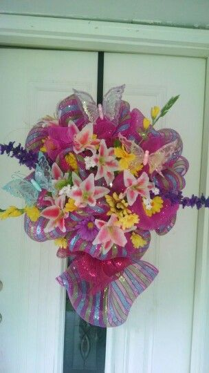 my summer wreath i made with some left over mesh and flowers