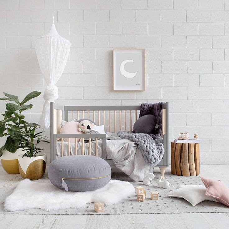 An adorable #nursery in grey tones. Loving the gold accent.