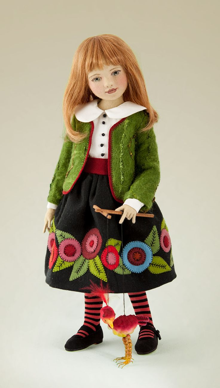 """""""Marcy and her New Toy"""": 16.5 Inch Tall Felt Doll, Special Limited Edition : 5  Created in 2013. Marcy is inspired from so many of Maggie's talents. The jacket she is wearing is made of fabric that Maggie has nano felted herself taking fibers of the just the right shades of green & combining silk threads for accents & texture. Marionette bird."""