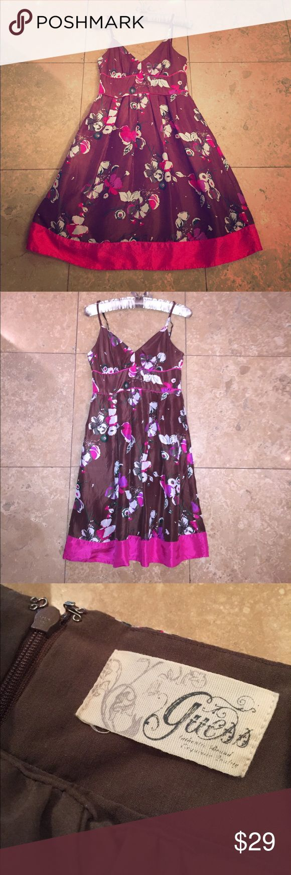 Guess dress EUC deep brown burgundy floral pink Excellent preowned condition Guess dress size 3. 100% silk with blended full lining. Fitted at the top with support for my chest. Lining is brown and dress is a brown with deep burgundy tones. Floral pattern and pink accents. Adjustable straps and zips up the back. Guess Dresses