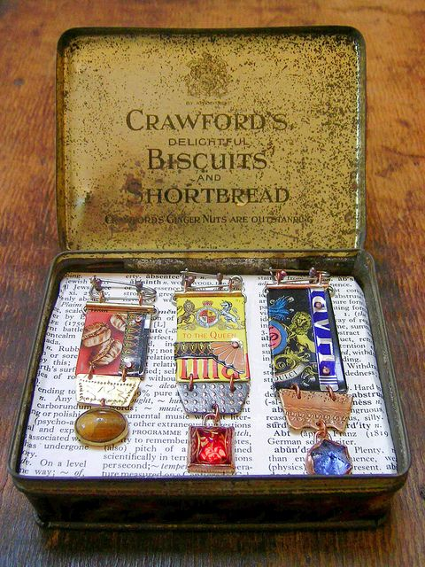 Made-up medals in a presentation tin. by fluxplay, via Flickr