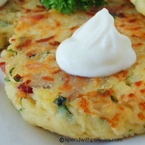 Mashed Potato Cakes: 2 cups cold mashed potatoes 1 cup shredded cheese (such as cheddar) 1/2 cup flour 6 strips bacon 1 medium onion, chopped 2 eggs 2 tbsp fresh basil, chopped 2 tbsp fresh parsley, chopped 2 cloves garlic, chopped 1 tsp salt 1/2 tsp pepper 4 tbsp butter or margarine