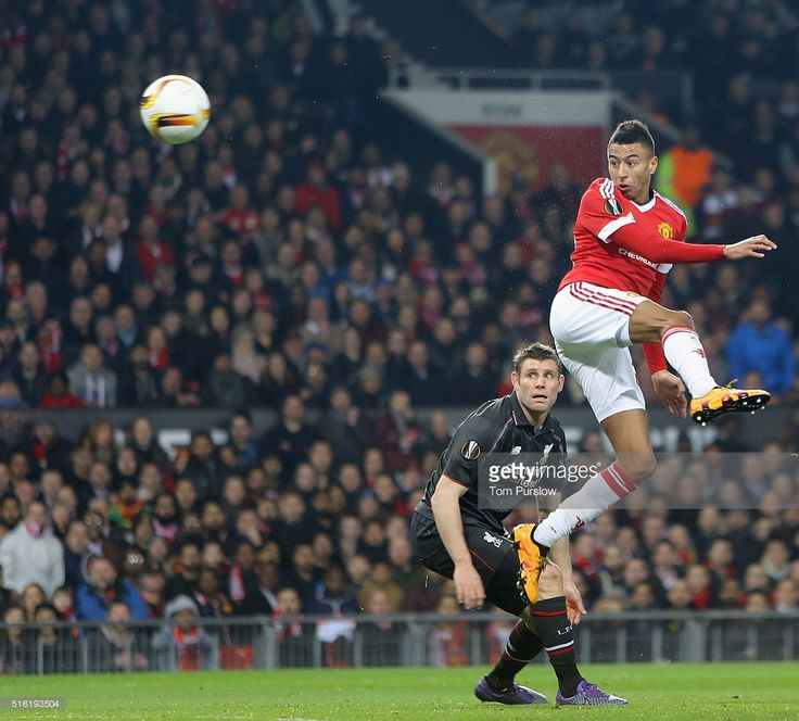 Jesse Lingard of Manchester United in action with James Milner of Liverpool during the UEFA Europa League Round of 16 Second Leg match between Manchester United and Liverpool at Old Trafford on March 17, 2016 in Manchester, United Kingdom.