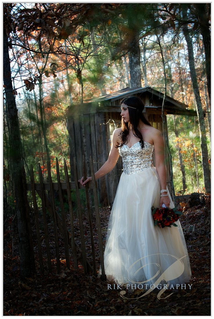 Bride in the woods at her fall wedding in Pigeon Forge. Click here for more from http://bluffmountaininn.com