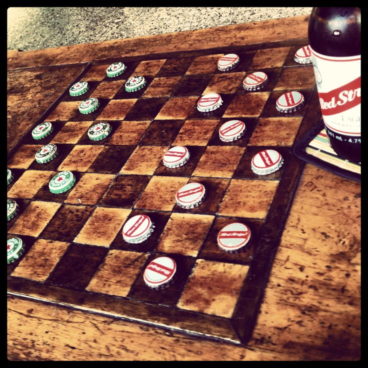 Could paint or even wood burn a checker board onto a table top or a whiskey barrel and use bottle caps for the checkers!