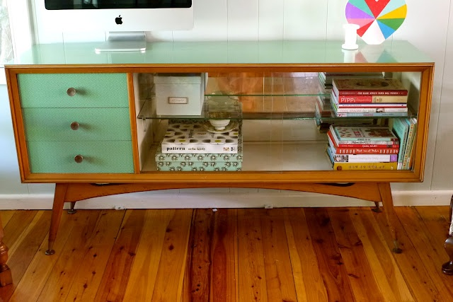Want/ need a retro sideboard/ cabinet like this... LOVE the colour of the drawers!