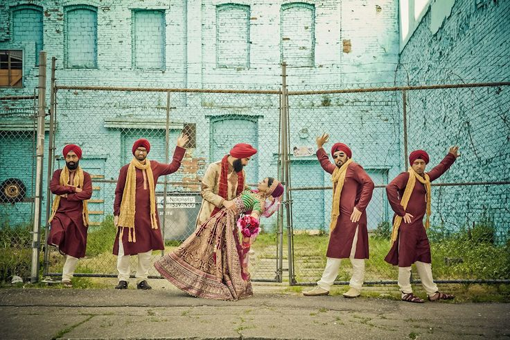 beautiful Indian bride, groom & groomsmen pose for a chic and colorful photo shoot