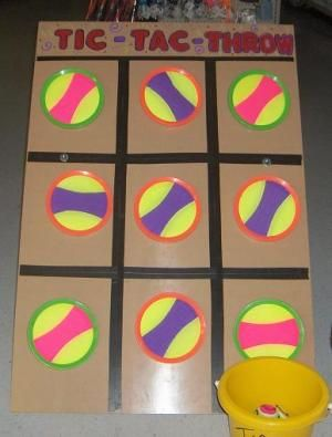 "Tic Tac Throw    Tic Tac Throw is so much fun!! Velcro pads """"catch"""" the Velcro balls while you try to beat your opponent at a game of Tic Tac Toe....playing agaist the game for a prize or against an opponent....this game is a must have for any carnival!!"