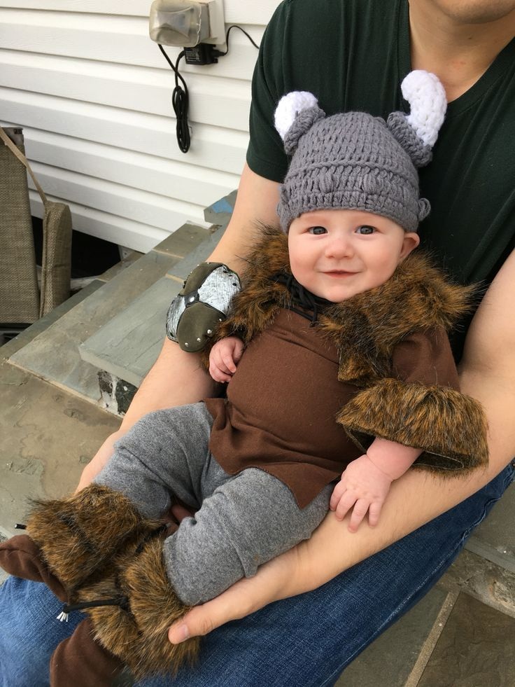 Baby's first Halloween costume! I made him a Viking tunic, boots, vest, and plush shield to go with the Viking knit cap we found online.