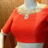 Pearl work blouse made in golden rawsilk. Boat neck style sleeveless. Designer blouses online - avlbl in standard & custom sizes. Delivered across India & USA. Super fast 3 day delivery available in India. Saree blouses online