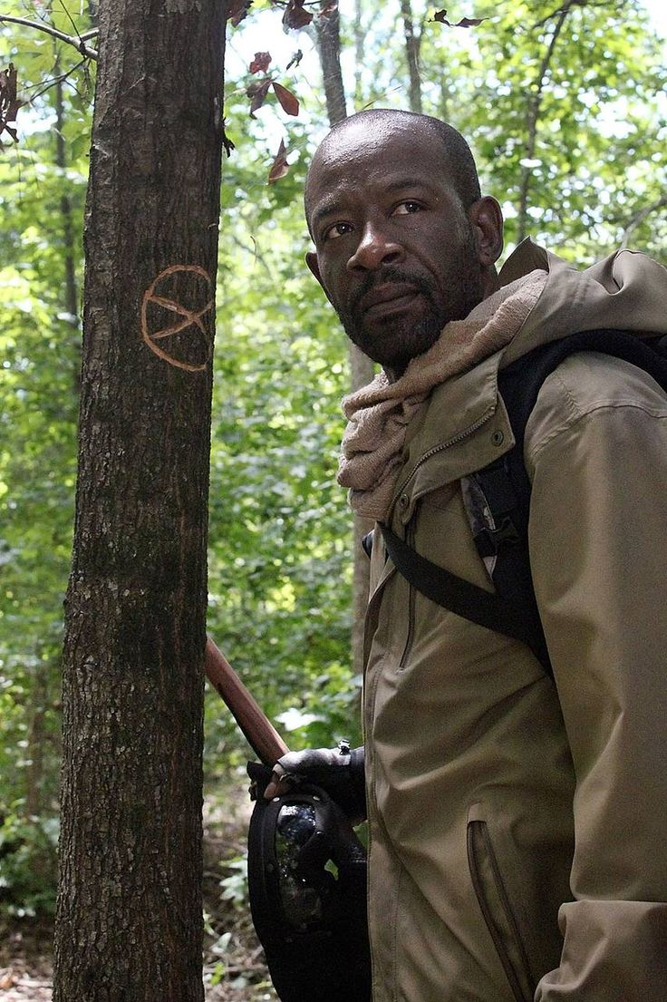 S5 E1; Morgan is Back ! ... At the end of season five premiere we see a person following Rick's group. The person reveals himself to be Morgan from S1, E1.