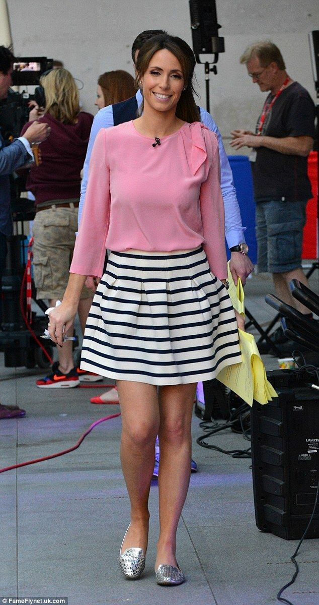 Pretty in pink: Alex Jones donned a salmon coloured top and a stripy skirt as she filmed T...