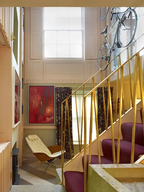 expansive wall space displays large pieces of contemporary art and the family's vintage bicycle collection. http://design-milk.com/narrow-townhouse-london-full-playful-details/