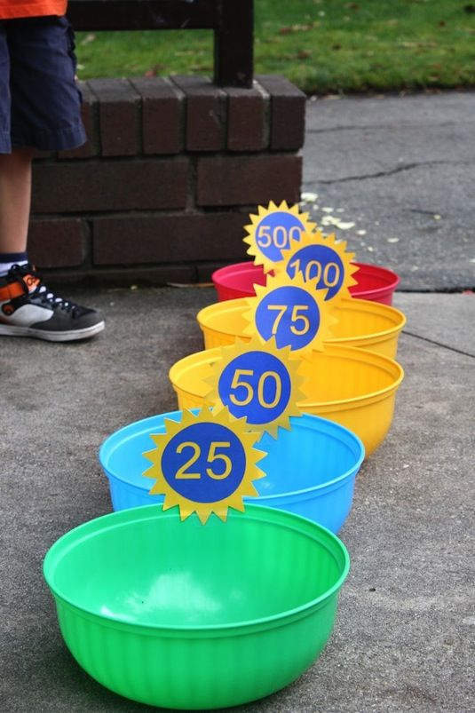 This bean bag toss game is cost-effective and easy to make. Grab different colored plastic bowls and create number signs for each bowl. Whoever tosses into the highest number in the end, wins!