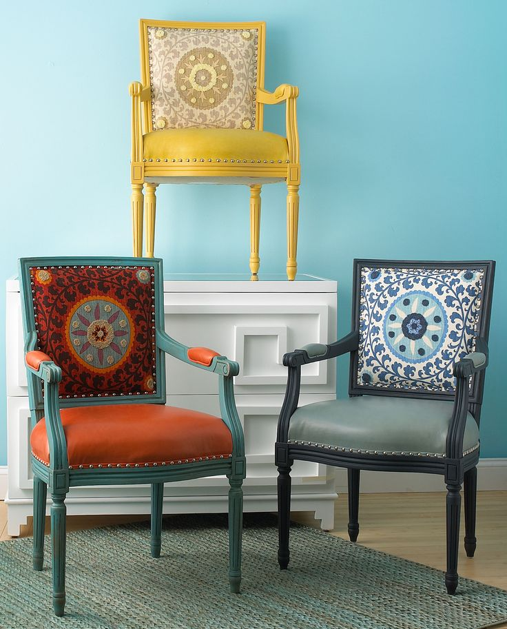 Suzani Side Chair 3 colors! The popular suzani design is featured on our sturdy wood framed side arm chair. This dimensional embroidered upholstery fabric pops with color and is matched with leather for the seat.