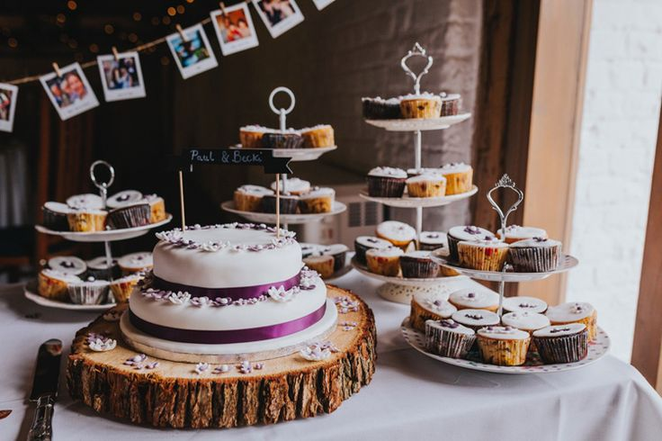 Can't decide between a tiered cake or cupcakes? Why not have both! Photo by Benjamin Stuart Photography #weddingphotography #weddingcake #cupcakes #weddingday #weddingfood