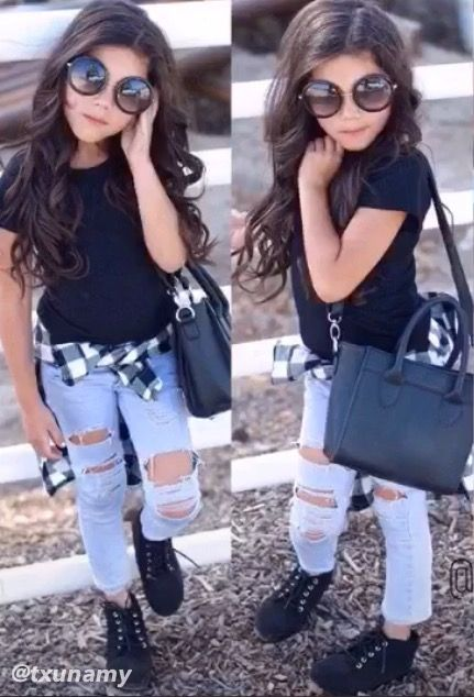 I like this because the little girl looks like a teen to her outfit with denim pants and black t`shirt.
