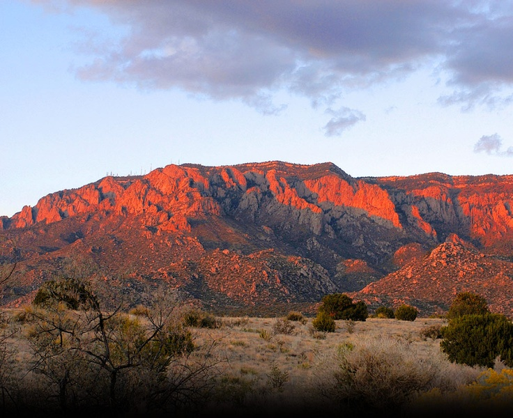 Sandia Mountain Sunset - this shows the watermelon color (sandia means watermelon in Spanish) Sandia Mountain Wilderness, part of Cibola National Forest, is located east of Albuquerque, New Mexico.