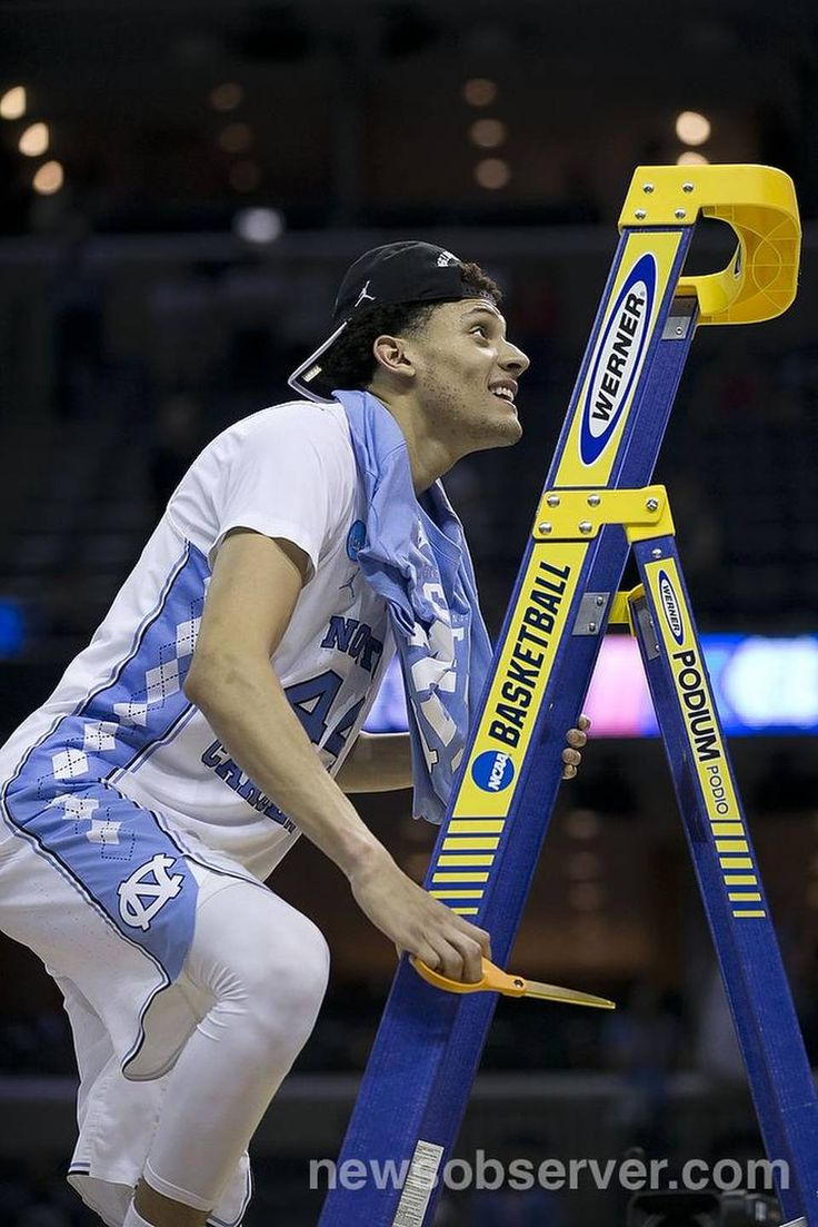 North Carolina's Justin Jackson (44) climbs the ladder to cut down the net following the Tar Heels' 75-73 victory over Kentucky in the NCAA South Regional Final on Sunday, March 26, 2017 at FedExForum in Memphis, TN.