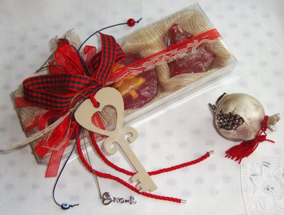 New Year Good Luck Unlocking Key Wooden Charm - New Year Eve Decorative Ornament. Use this handmade wooden Key - Charm for Good Luck to unlock the Luck for 2017! It is the decoration of a gorgeous smelling Beige Cream Color Christmas Handmade Gift Set, containing 3 small red Christmas shaped Luxury Soaps in amber scent and this lovely handmade Wooden Key in the packaging. Happy New Year !