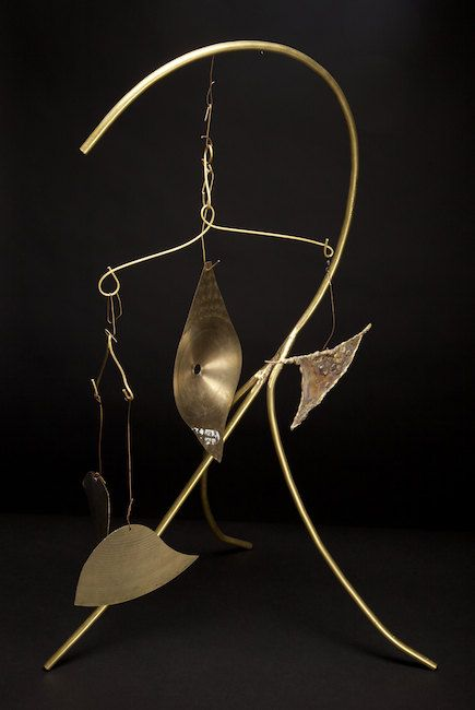 Abstract sculpture created from brass tubing and cymbal parts on Etsy, $250.00