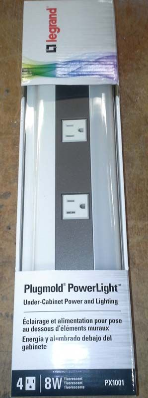 Legrand Wiremold under-cabinet power strip in the white packaging.