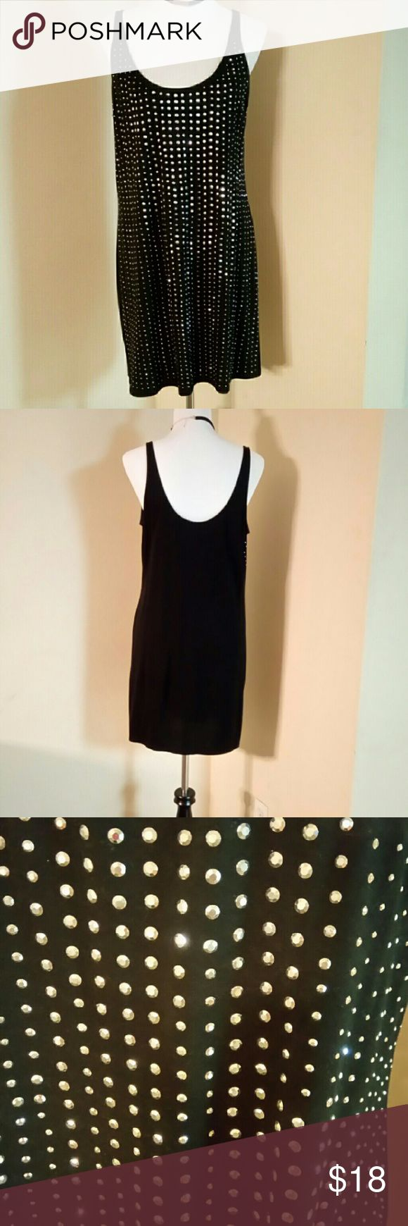 Express studded dress Very comfortable dress either dress it up as casual or night out. All studs in the front. 27 inches from armpit down, 20 inches waist. 60% cotton, 40% modal. Worn twice. Express Dresses Midi