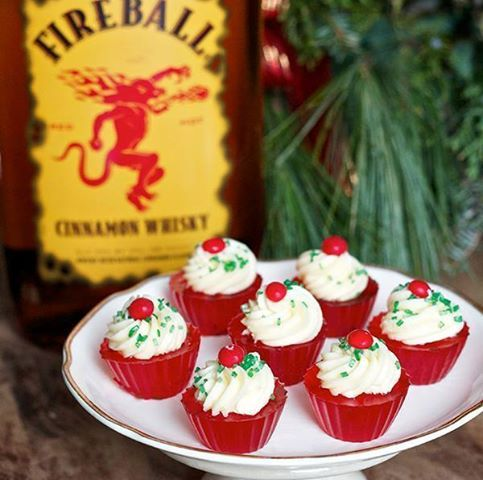 Fireball Jello Shot Cupcakes Makes 30 Jello Shots Ingredients: * 1 and 1/3 cup ginger ale * 2 envelopes plain gelatin * 2/3 cup Fireball Whisky * A few drops of red food coloring * Any brand of Buttercream frosting  Directions: * Lightly spray cupcake molds with non-stick spray * Pour ginger ale into a medium saucepan and sprinkle in gelatin - allow to soak for 2-3 minutes * Heat on low, stirring constantly until gelatin is fully dissolved (about 5 minutes) * Remove saucepan from heat and…