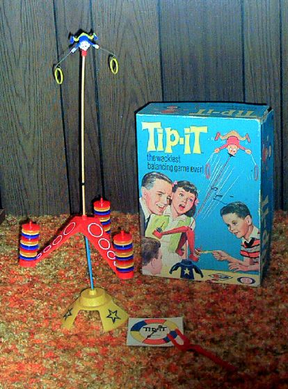 My favorite childhood toys!  Tip-It and Battling Tops were my absolute faves.  My Dad used to play these with my sister and I.  *sigh*  :o)