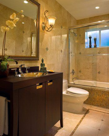 Hard sharp surfaces are bad Feng Shui the green plant helps and a shower curtain and some towels would create a better balance to counteract the tile.
