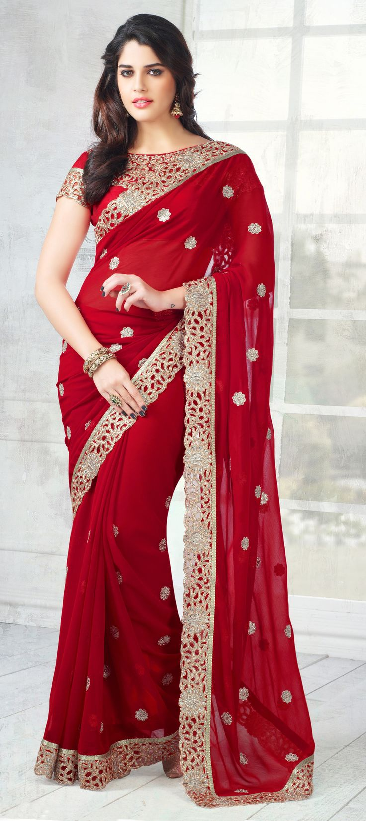146715: Red and Maroon color family Saree with matching unstitched blouse.