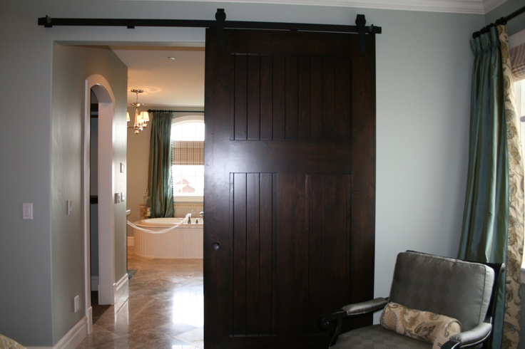 Barn door separating master bedroom and bathroom barn for Bedroom barn door hardware