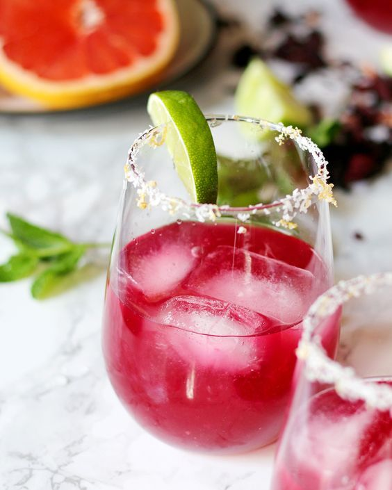 This grapefruit hibiscus margarita is the perfect cocktail recipe to make you think of summer! Fresh grapefruit and lime juice, homemade hibiscus simple syrup and a little muddled mint make this a fun and tropical cocktail! | honeyandbirch.com: