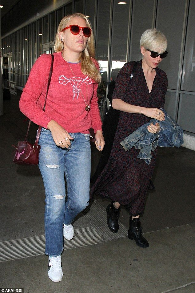 'The best BFF!' Busy Philipps wears a uterus sweatshirt as she jets off hand in hand with ...