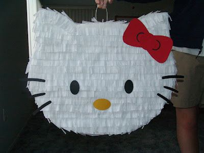 Hello Kitty Pinata - cut out shape out of cardboard, fill with candy, tape.  Cover in crepe paper.  Done!