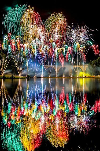 Happy New Year! A spectacular firework display over the lake at Saint-Yrieix-la-Perche in France