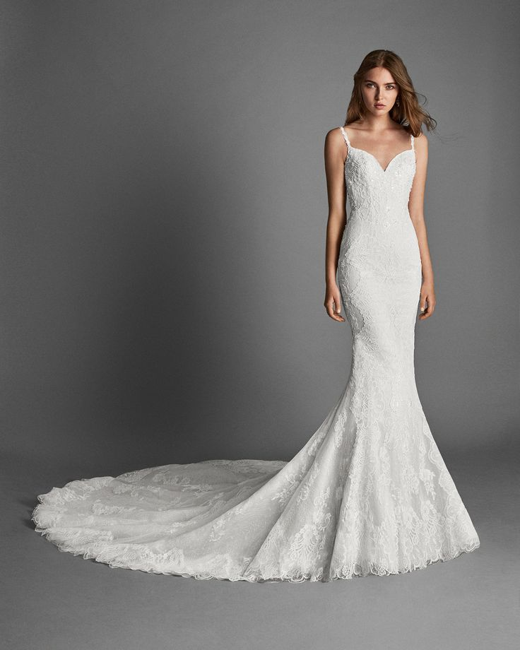 2018 Alma Novia Collection RIA Mermaid-style beaded lace wedding dress with low back.