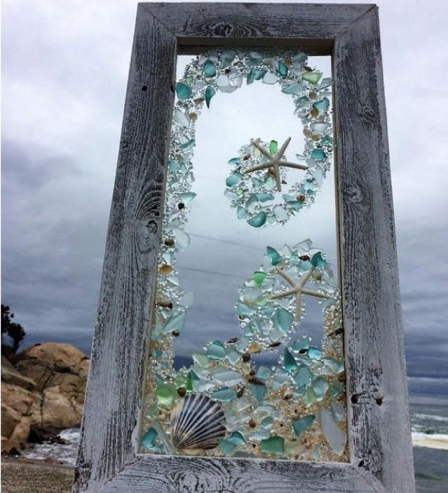 Sea glass and shells on an old window! Beautiful!