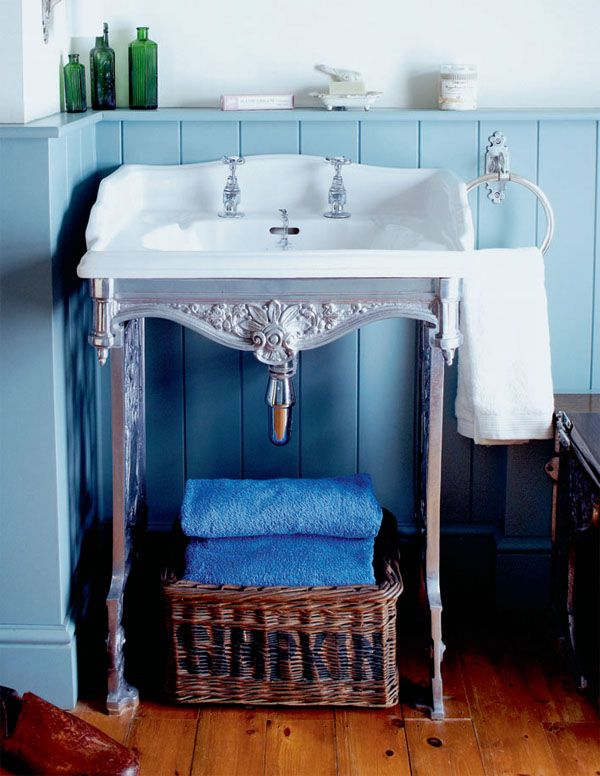 @Jessica Burbon, I like the chair rail with a built in ledge for all kinds of pretty things in a tiny sparkly bathroom!