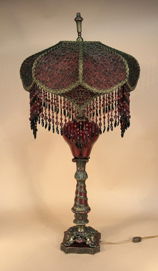 cream puff shaped shade is burgundy covered with black lace and