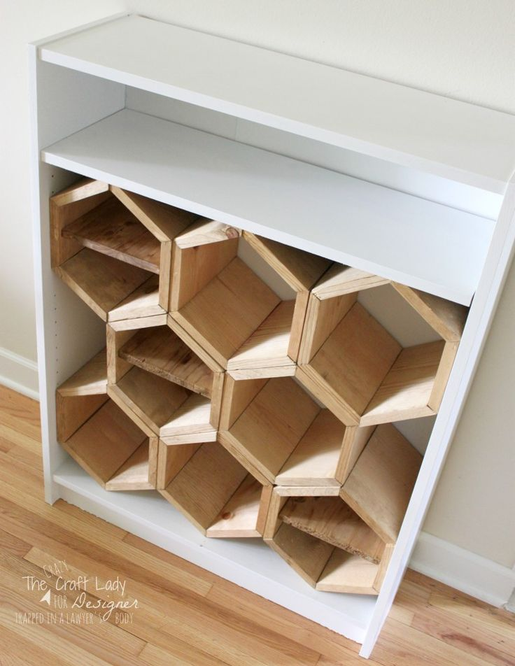 Make a DIY shoe rack using an old bookshelf and making hexagon inserts to hold the shoes!  Full tutorial by The Crazy Craft Lady for Designer Trapped in a Lawyer's Body.