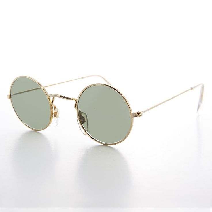 The perfect John Lennon-style round sunglass has arrived at the Sunglass Museum. These sunglasses feature ground and polished optical quality glass lenses. The frame is perfect in size, and the temple